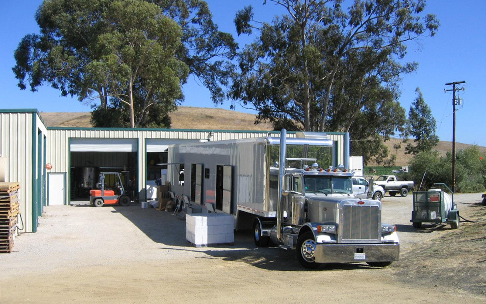 A large mobile bottling line truck